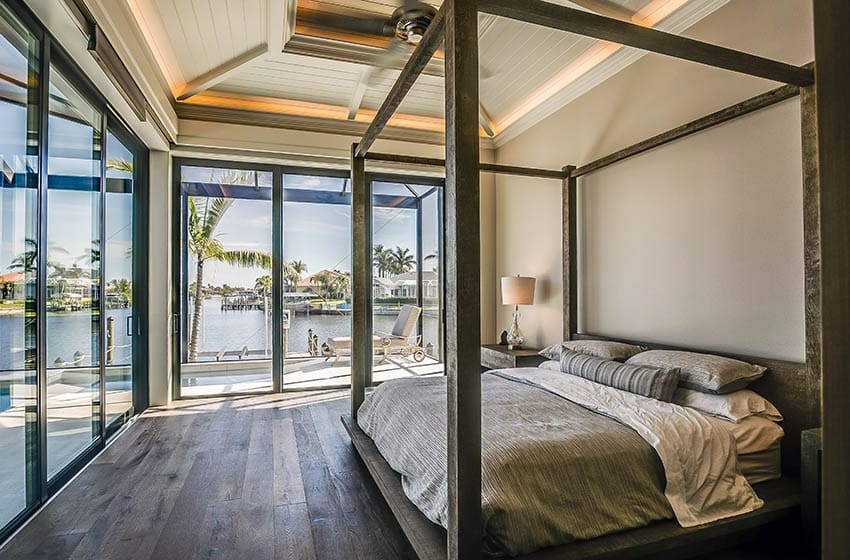 Bedroom ceiling strip lights wraparound windows with water views