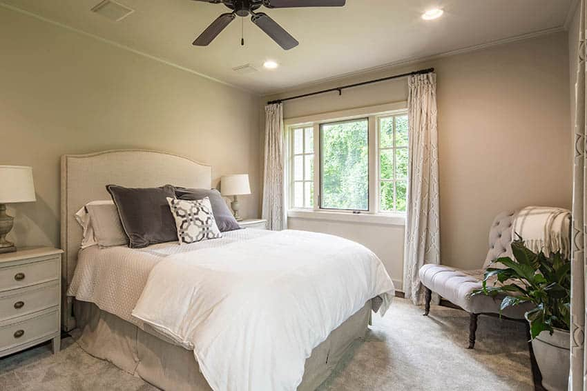Bedroom with taupe carpet