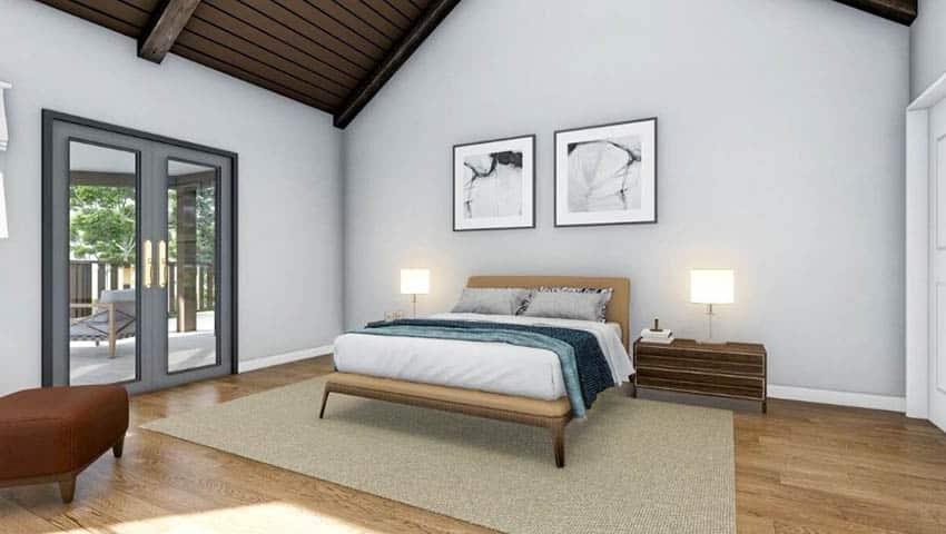 Bedroom with vaulted wood ceiling wood flooring double door to patio
