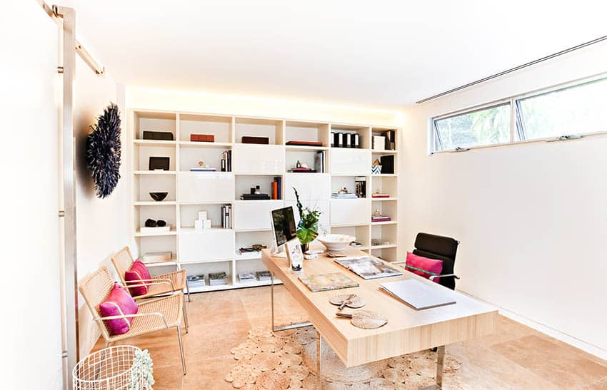 Bright basement home office with built in storage wood desk