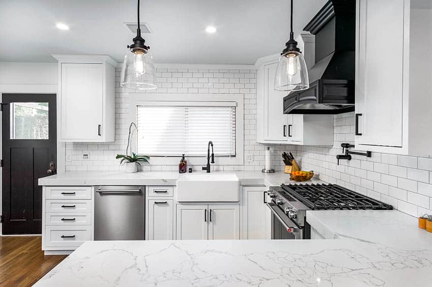 C shaped kitchen with quartz look corian solid surface countertops