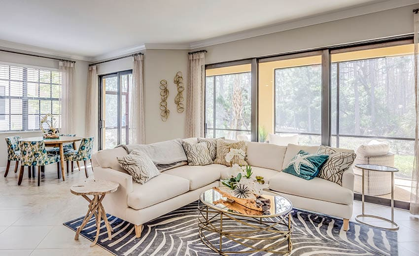 Coastal sectional sofa with large striped area rug