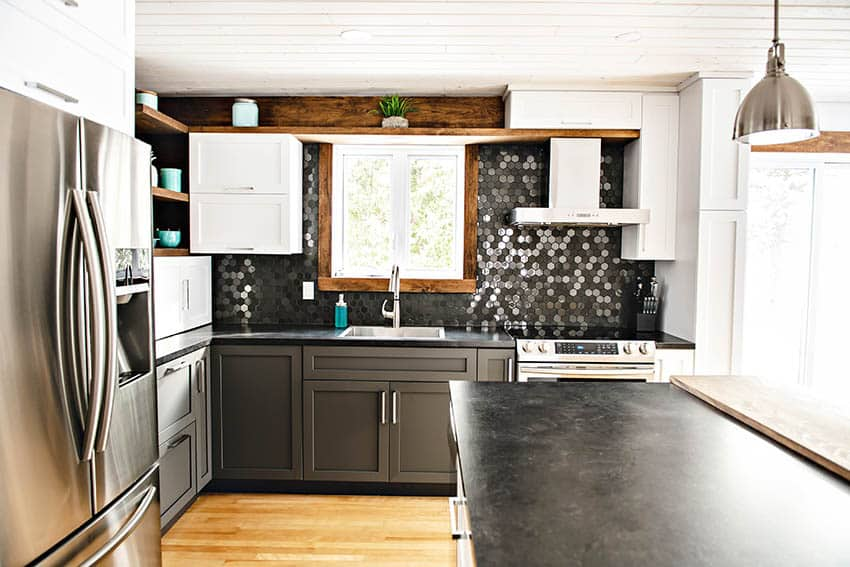 Contemporary kitchen with slate countertops mosaic tile backsplash two color cabinets