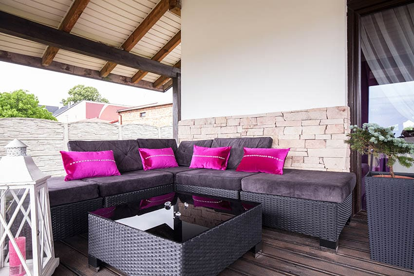 Covered deck with outdoor sectional sofa with microfiber fabric