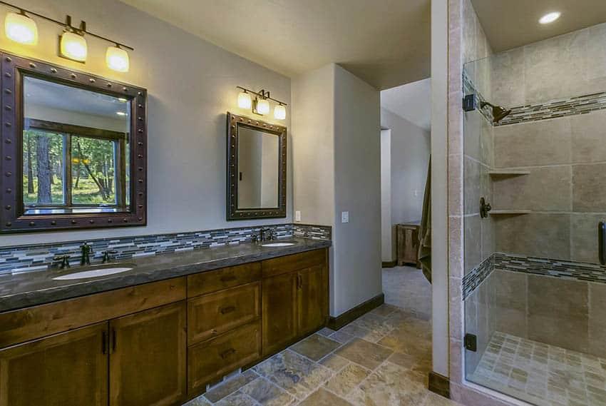 Craftsman master bathroom with dual vanity travertine shower flooring