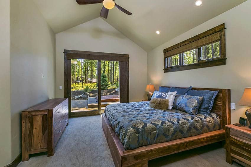 Craftsman master bedroom with sliding door to patio with hot tub