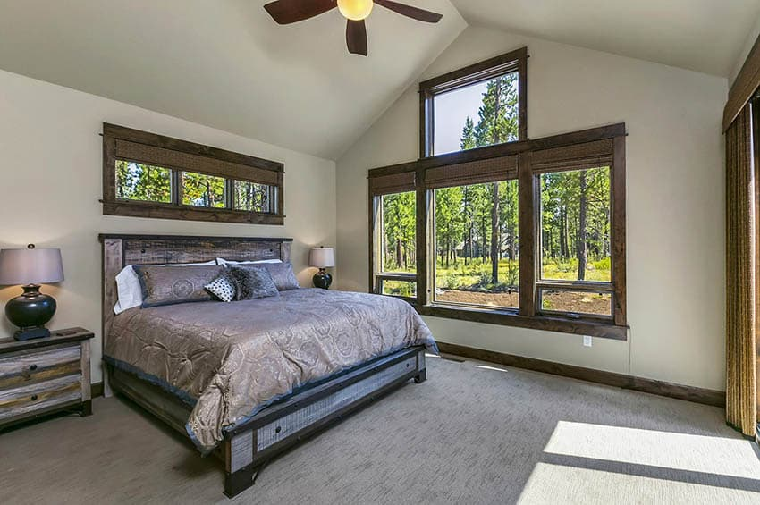 Craftsman style bedroom with wood frame windows