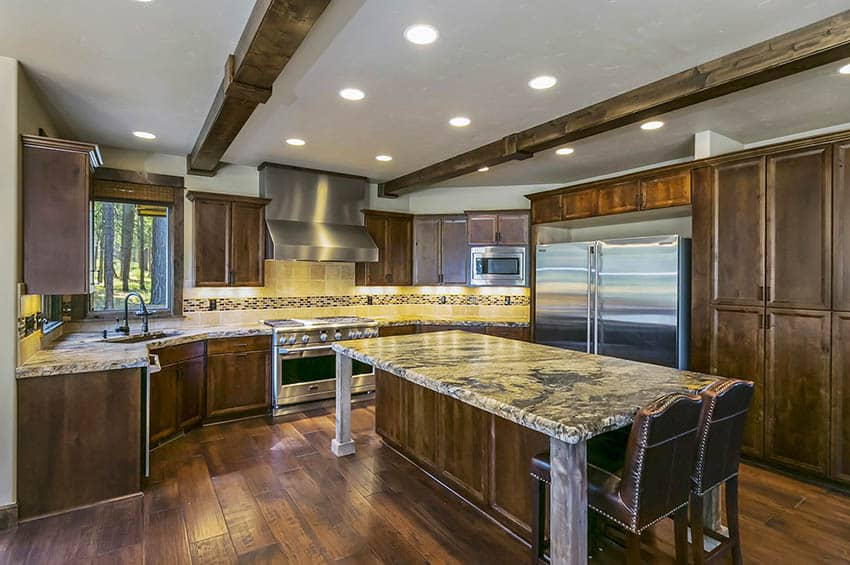 Craftsman style kitchen with solid wood cabinets granite countertops wood plank flooring wood beams
