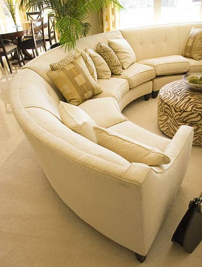 Curved sectional sofa with cushions