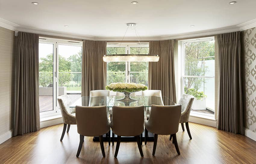 Dining room with bay window and curtains