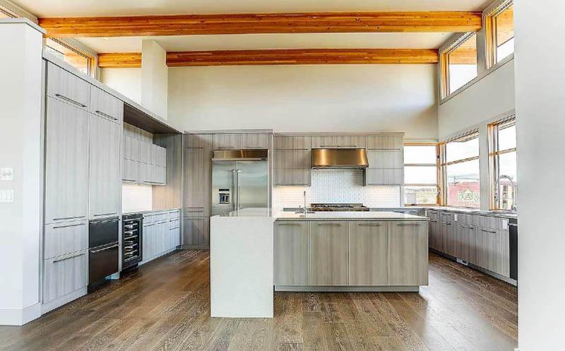 Dream kitchen with wood veneer cabinets quartz island open wood beams