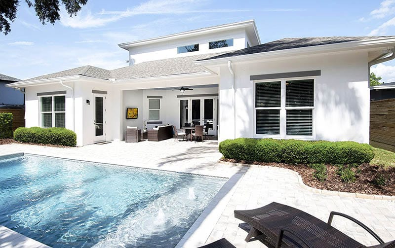Florida house plan backyard with swimming pool covered patio