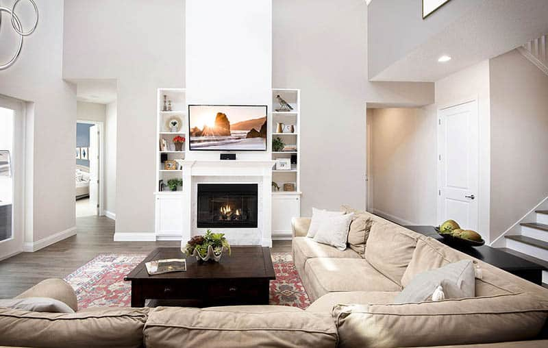 Great room with high ceiling fireplace with hearth sectional sofa
