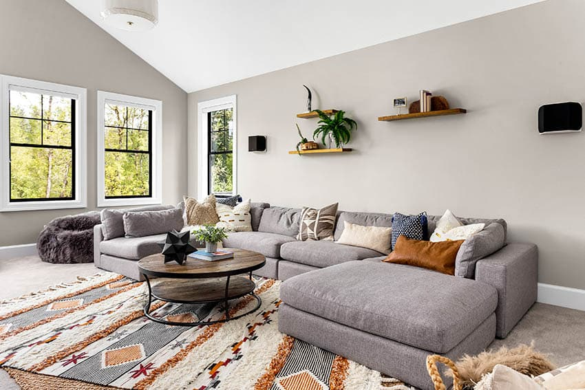 Grey contemporary sectional sofa with circular coffee table
