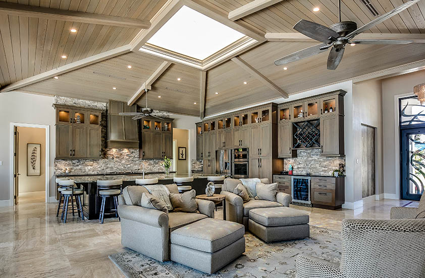 High ceiling living room with recessed lights skylight
