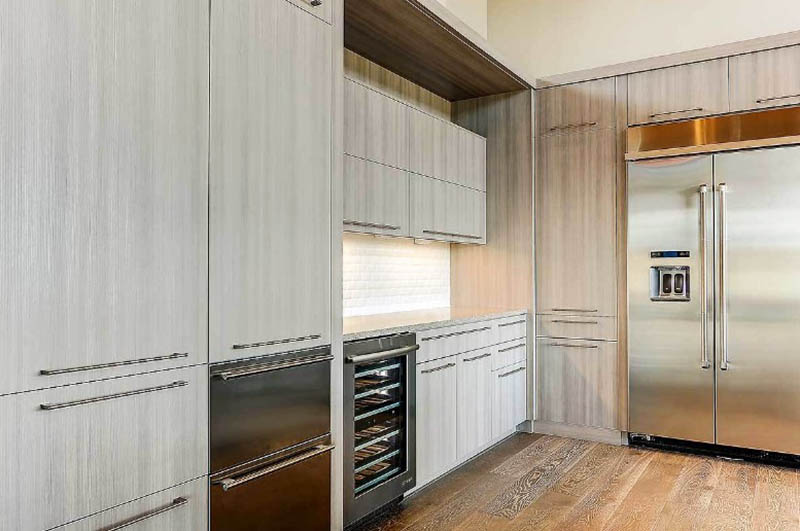 High kitchen cabinets with built in freezer and wine refrigerator