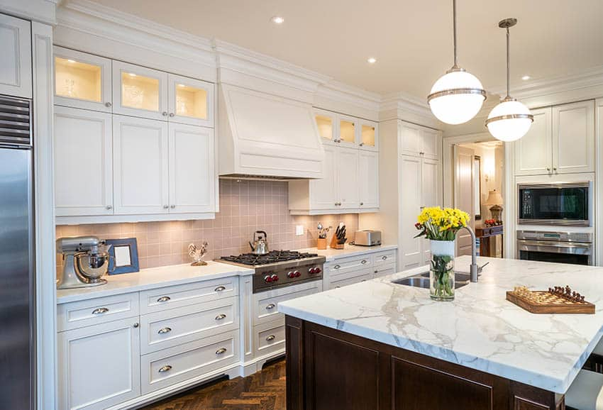 Kitchen with globe pendant light fixtures above island