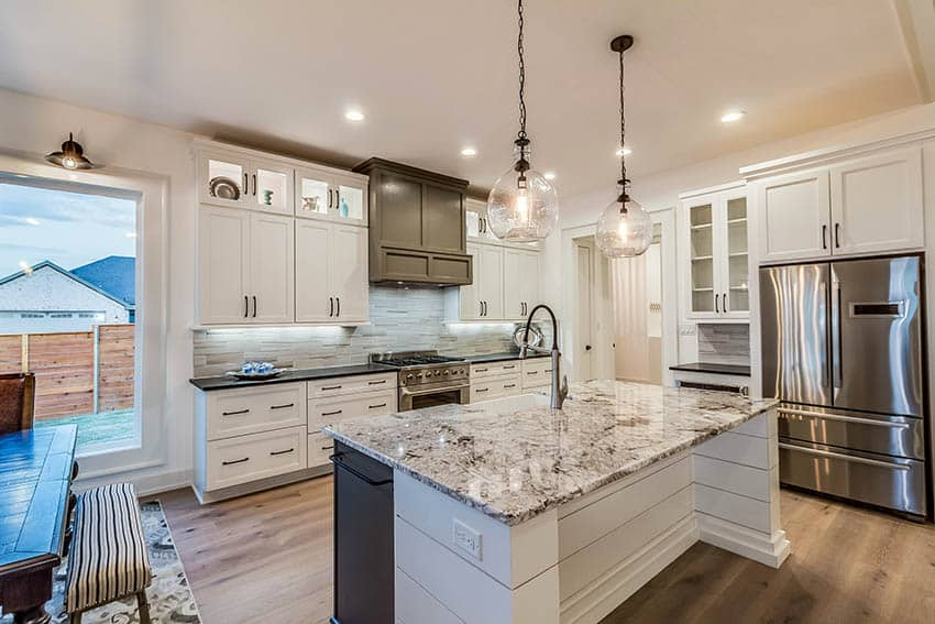 Kitchen with pendant lights above island and recessed ceiling light fixtures