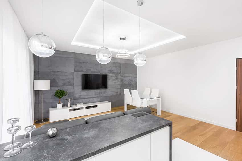 Kitchen with slate countertops and fireplace with slate cladding
