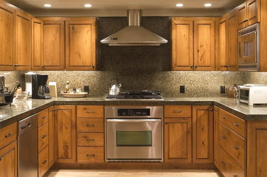 Kitchen with stained wood cabinets