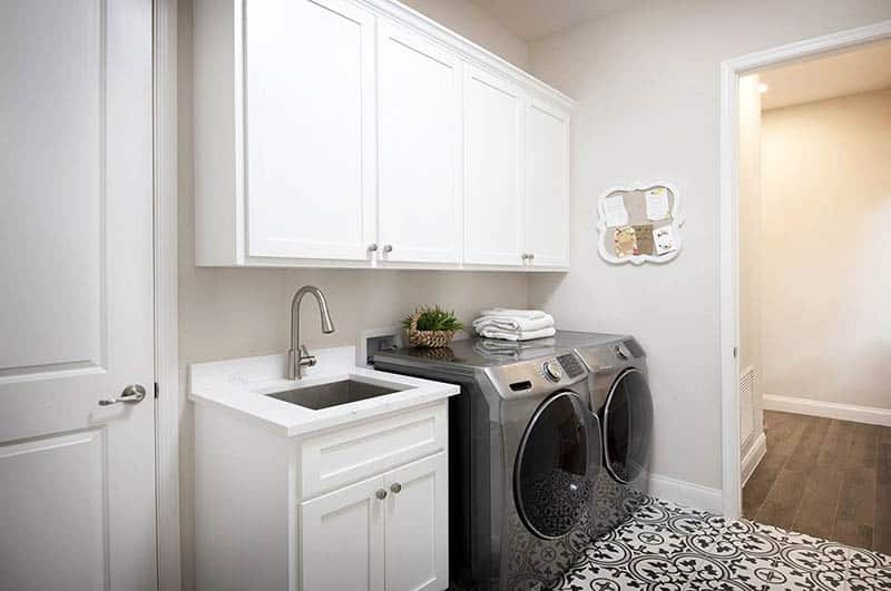 Laundry room with built in cabinet storage