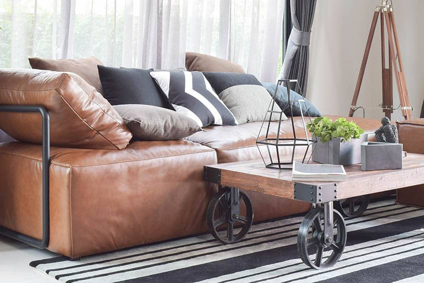 Light brown leather sofa in living room with industrial style coffee table