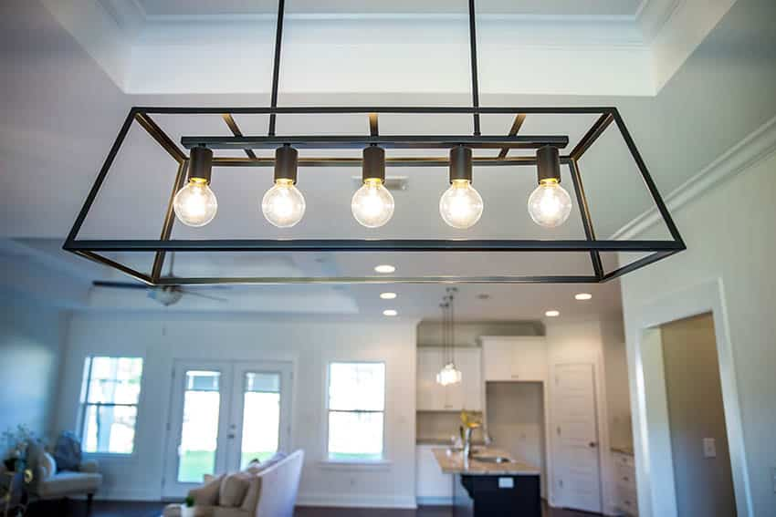 Linear light fixture above dining table