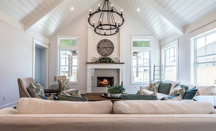 Living room with cathedral ceiling chandelier and recessed light fixtures