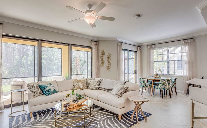 Living room with ceiling fan with light