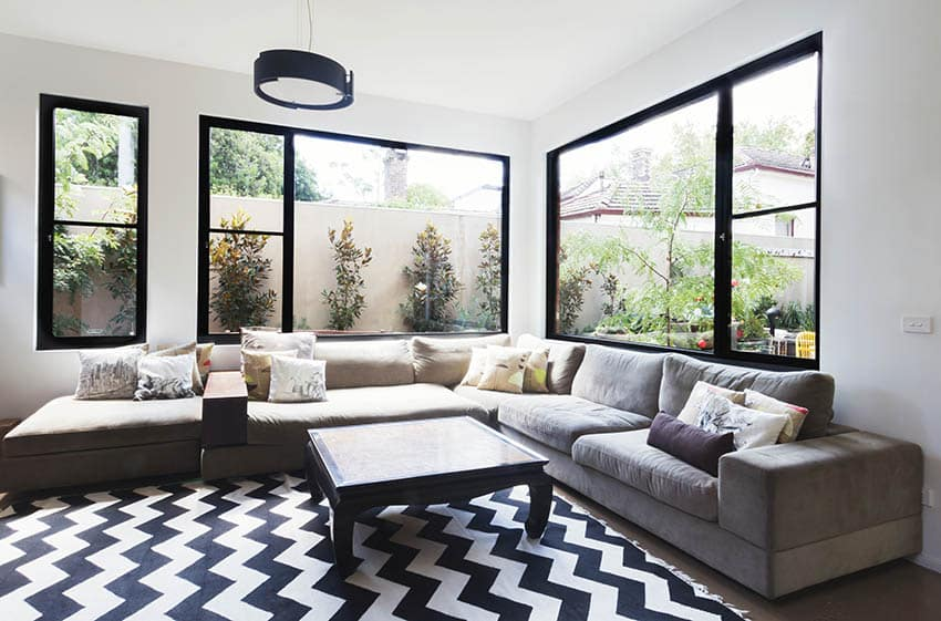 Living room with corner picture windows with side windows