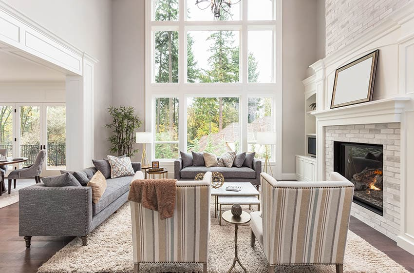 Living room with picture windows with side windows
