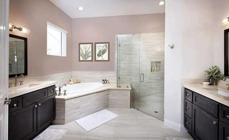 Master bathroom with corner tun and shower his and her vanity