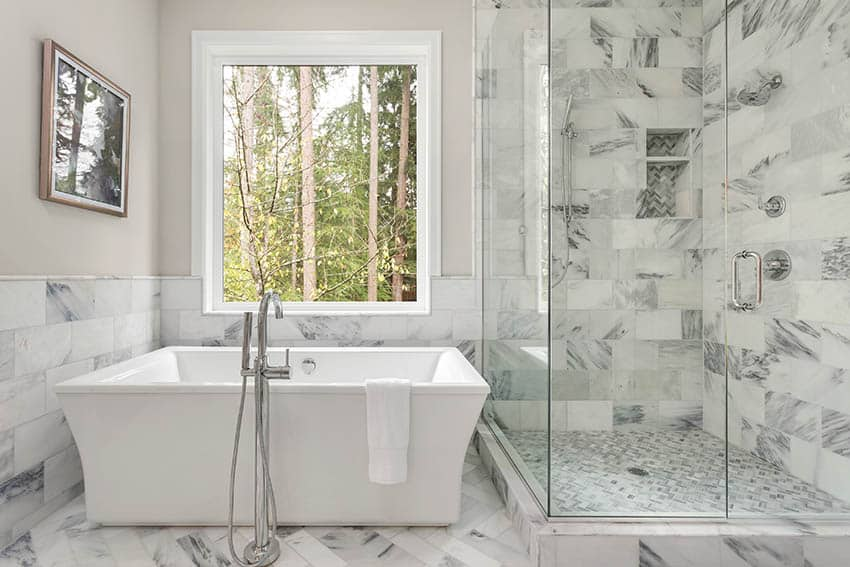 Master bathroom with picture window above tub
