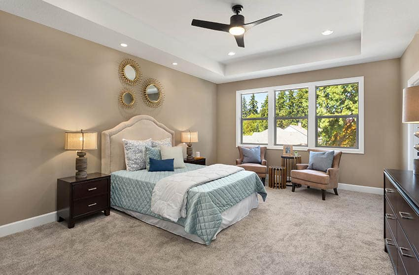 Master bedroom with light brown carpet