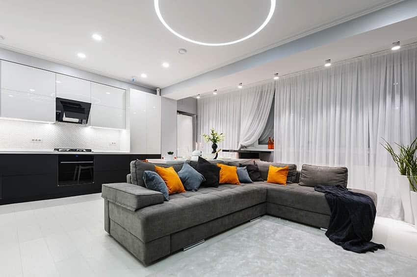 Modern living room sectional sofa decorative pillows led lighting black white cabinet kitchen