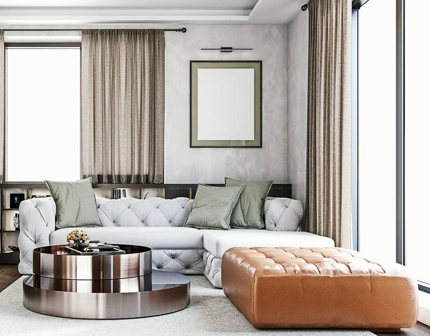 Modern living room with tufted back sectional sofa leather ottoman and coffee table