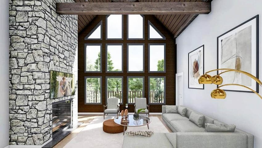 Mountain cottage living room with vaulted ceiling wood beam stone fireplace
