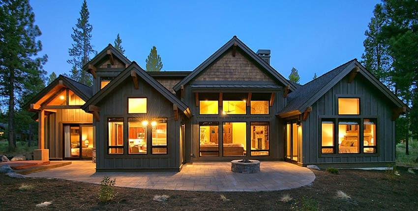 Mountain craftsman house backyard with concrete paver patio fire pit