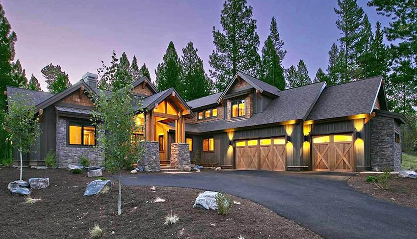 Mountain craftsman house plan exterior with stone entry 3 car garage
