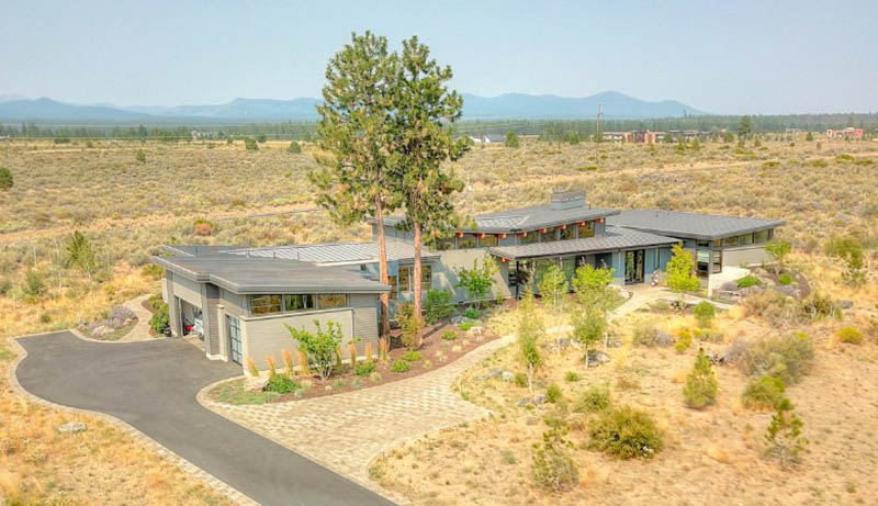 Mountain ranch home plan with pathway 3 car garage