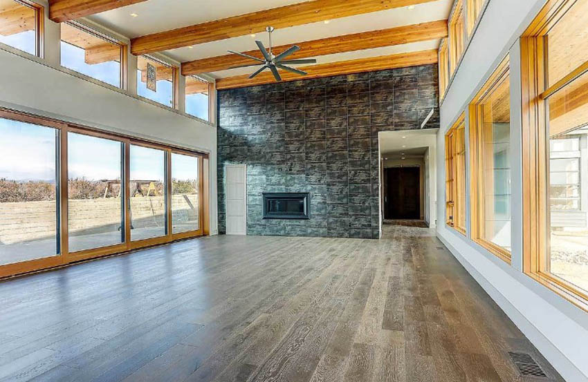 Open style living room design with exposed wood trusses
