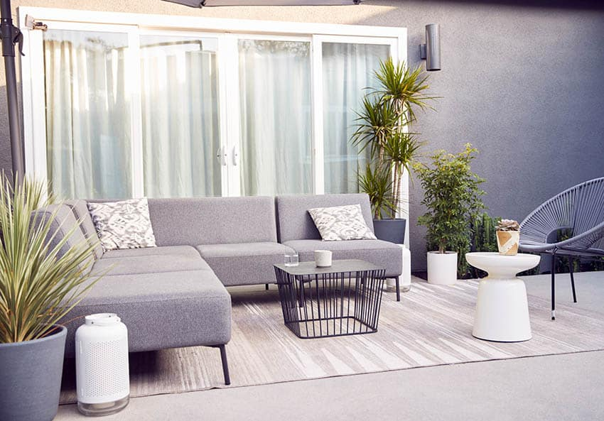 Outdoor sectional sofa with area rug and wire coffee table
