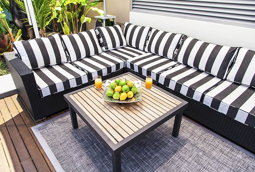 Outdoor striped sectional sofa with black and white pattern
