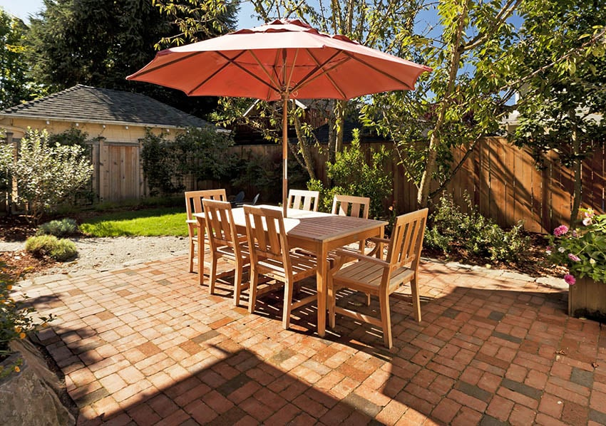 Paver patio with wood outdoor dining table