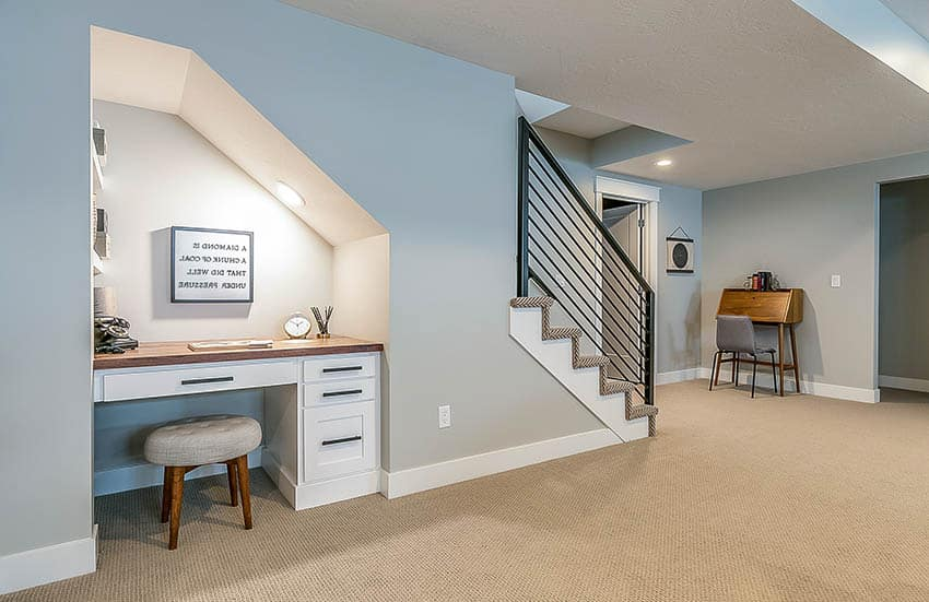 Small basement home office under stairs with recessed lighting