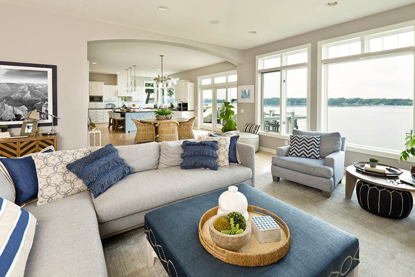 Transitional sectional sofa in living room with large ottoman