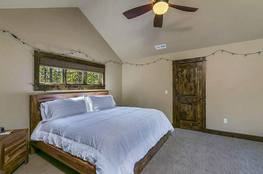 Upstairs guest bedroom with solid wood furniture window frames doors