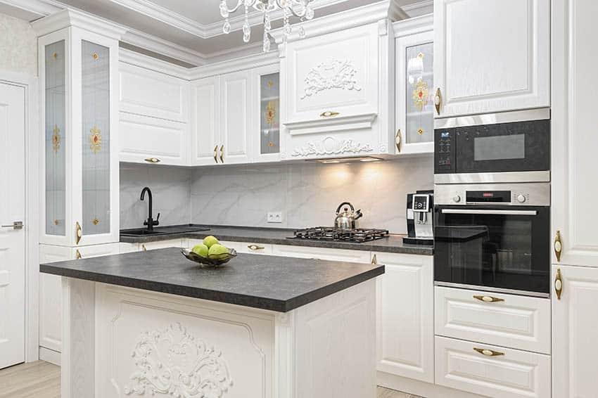 White kitchen with slate countertops island motif