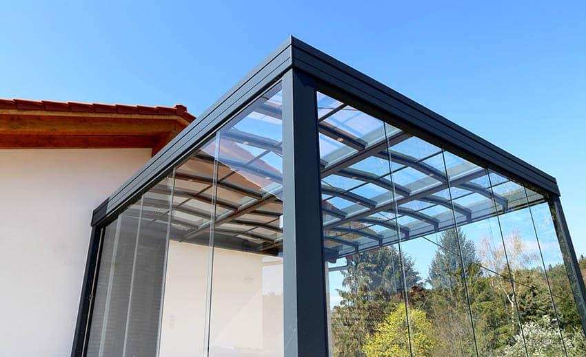 Aluminum patio enclosure next to house