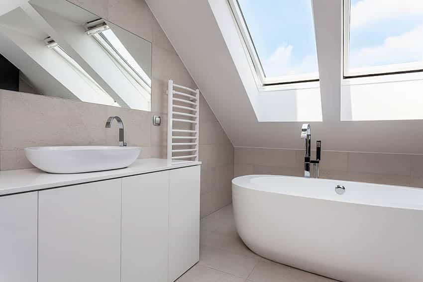 Attic bathroom with vessel sink freestanding tub